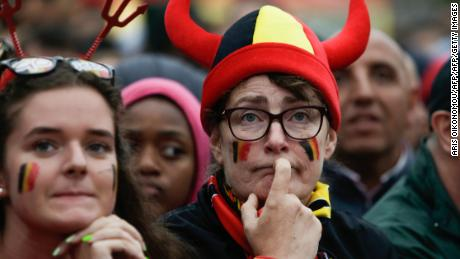 Belgium supporters at a fan zone in Brussels react after France's scores its first goal.
