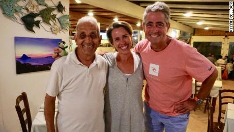 Tonino delights in welcoming patrons to his restaurant on Tavolara. Pictured is Tonino, Kellie Pollock and her husband, Jonathan Pollock.