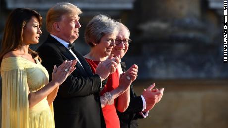 Trump tries to ease tensions with May after incendiary interview