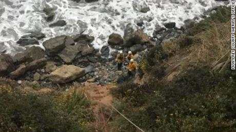 Emergency personnel used ropes to pull the woman up from the bottom of the cliff