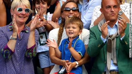 Novak Djokovic's son Stefan, 3, watches his father hoist the Wimbledon trophy in July 2018.