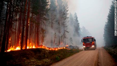 A fire vehicle is seen as fire burns in Karbole, Sweden, on July 15, 2018. - Due to the dry weather, 80 wildfires burned in Sweden. (Photo by Mats ANDERSSON / TT News Agency / AFP) / Sweden OUT        (Photo credit should read MATS ANDERSSON/AFP/Getty Images)
