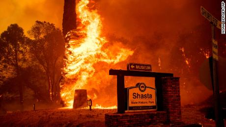 The Carr Fire tears through Shasta, Calif., Thursday, July 26, 2018. Fueled by high temperatures, wind and low humidity, the blaze destroyed multiple homes and at least one historic building. (AP Photo/Noah Berger)