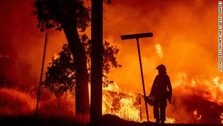 A firefighter battles the Carr fire in Redding California