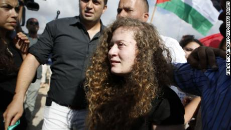 Palestinian girl, 17, filmed kicking Israeli soldiers is freed from prison