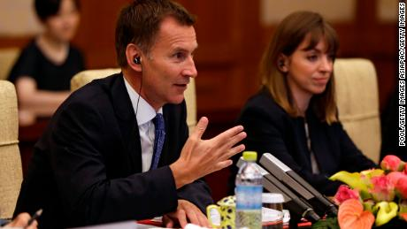 Britain's Foreign Minister Jeremy Hunt accidentally called his Chinese-born wife Japanese during a meeting with Chinese Foreign Minister Wang Yi in Beijing on Monday