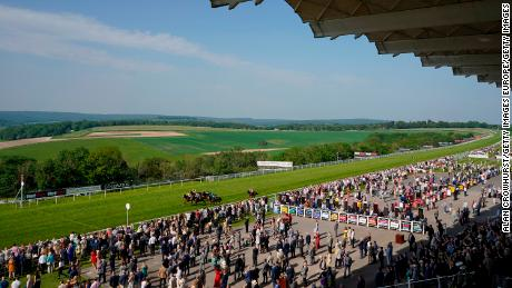 A general view as runners approach the finish at Goodwood Racecourse.