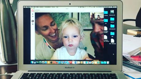 Writer Liz Tigelaar video chats with her son while she works on a pilot project.