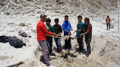 Researchers from the Mount Everest Biogas Project test soil at Gorak Shep.
