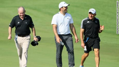 Italian golfer Francesco Molinari (center) with swing coach Denis Pugh (left) and performance coach Dave Alred (right).