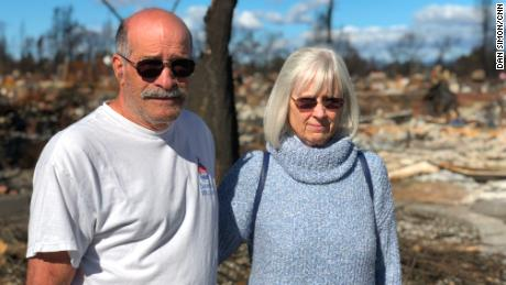 John Wimmer and his wife, Jody, visit their neighborhood following the 2017 wildfire.