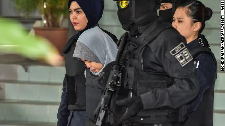 Siti Aisyah (center) is escorted by Malaysian police after a court session for her trial at the Shah Alam High Court in Shah Alam, outside Kuala Lumpur on June 27.