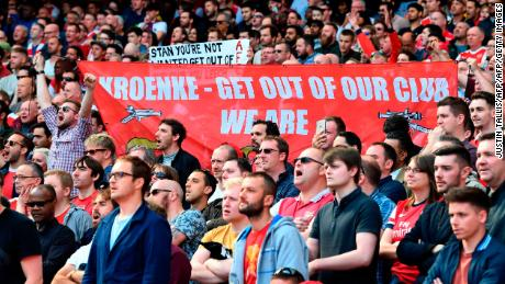 Arsenal fans hold up a banner against Arsenal's majority owner Stan Kroenke during the English Premier League football match between Arsenal and Everton on May 21, 2017.