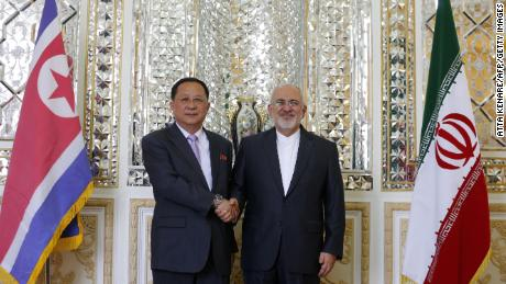 Iranian Foreign Minister Mohammad Javad Zarif right greets North Korean Foreign Minister Ri Yong Ho in Tehran on Tuesday