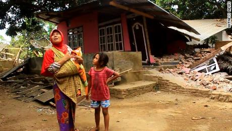 Sumiati returned to her home to survey the damage and found the roof partially collapsed