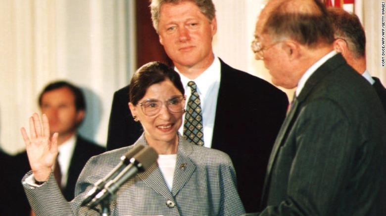 WASHINGTON DC- AUGUST 10 Chief Justice of the U.S. Supreme Court William Rehnquist administers the oath of office to newly-appointed U.S. Supreme Court Justice Ruth Bader Ginsburg as U.S. President Bill Clinton looks on 10 August 1993. Ginsbur