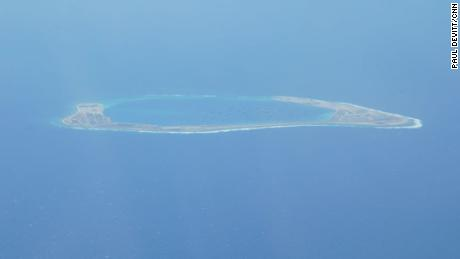 The Chinese-controlled artificial island of Subi Reef in the South China Sea, as seen by CNN from a US reconnaissance plane on August 10.