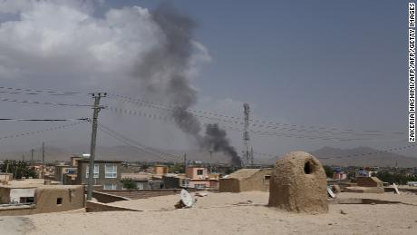 Smoke is seen rising into the air after Taliban militants launched an attack on the Afghan provincial capital of Ghazni on Friday