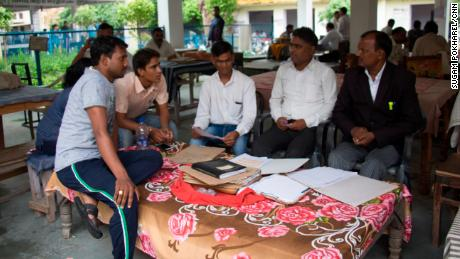 The staff of the local NGO, Jan Sahas operating in Bharatpur, Rajasthan sitting outside the local court and parsing through case files with Tarachand Pohiya, a lawyer who works with them.