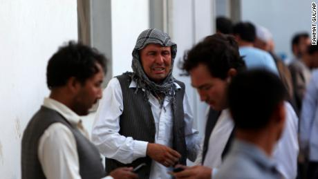 Afghans mourn a victim of the deadly suicide bombing