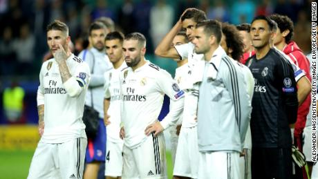 Real captain Sergio Ramos and teammates look dejected following defeat.
