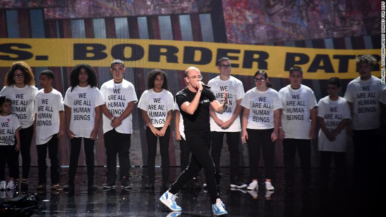Logic stages immigrant protest at VMAs with parents, kids