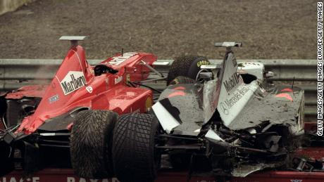30 Aug 1998:  The Ferrari of Eddie Irvine and the Maclaren Mercedes of David Coulthard loaded on a recovery vehicle after the crash.