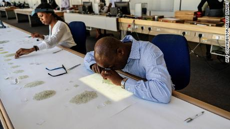 Employees grade and store rough diamonds at the Namibian Diamonds Trading Company in Windhoek, Namibia.