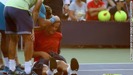 Mikhail Youzhny of Russia struggling with heat exhaustion during his first round match against Marcos Baghdatis of Cyprus at the US Open.