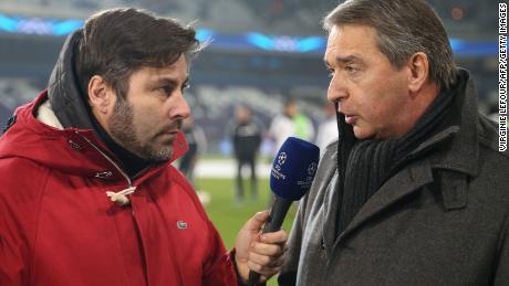 Belgian sport journalist and presentator Stephane Pauwels (L) speaks with Herman Van Holsbeeck ahead of Champions League group C the football match on November 27, 2013 in Brussels.