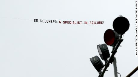A banner reading 'Ed Woodward a specialist in failure!' is flown over Turf Moor