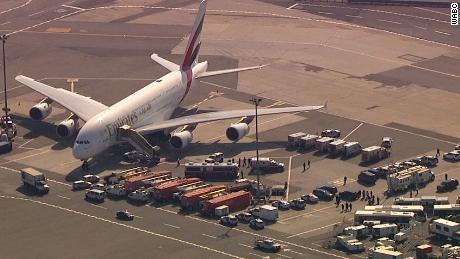 At least 19 on quarantined Emirates flight confirmed sick