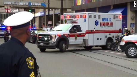 Authorities respond to the scene of a shooting at Cincinnati's Fountain Square