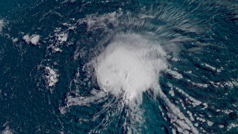 Florence gains hurricane status as it tracks towards east coast