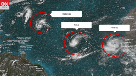 This image, taken shortly before noon Saturday ET, shows Tropical Storm Florence, Tropical Depression Nine and Tropical Storm Helene.