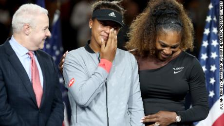 Naomi Osaka (center) was in tears during the presentation ceremony.