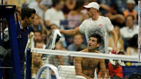 Novak Djokovic stayed in court while John Millman of Australia left the pitch to change his shirt due to the humidity during a US Open Men's singles quarter-finals match on Wednesday.