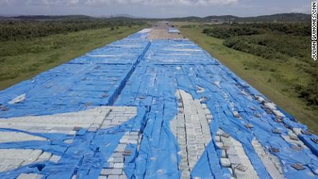 Stacks upon stacks of bottled water sit near a runway in Ceiba Puerto Rico