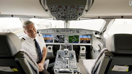 airBaltic chief pilot Gerhard Ramcke in the cockpit of an Airbus A220-300