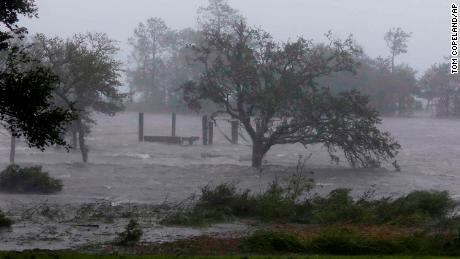 High winds and a storm surge from Florence hits Swansboro, North Carolina, on Friday.