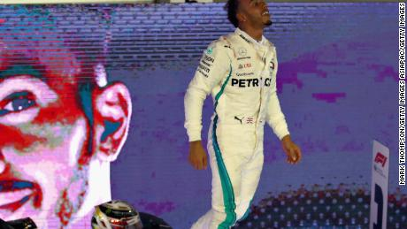Lewis Hamilton celebrates after his brilliant victory in the Singapore Grand Prix.