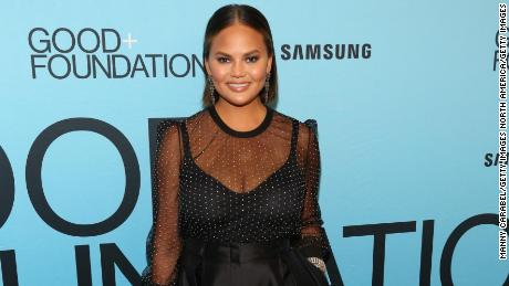 Chrissy Teigen buys her red carpet gowns, re-sells them for charity