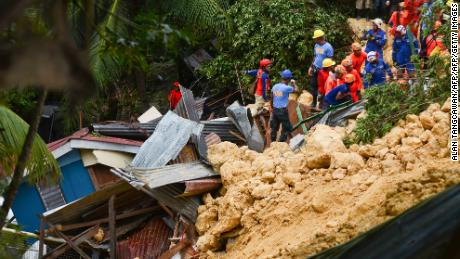 Rescuers search for landslide survivors in Naga City on the popular tourist island of Cebu