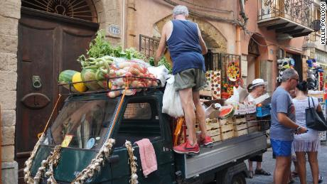 Sometimes the market comes to you. Fresh fruit and vegetables sold off a cart in Cefalu Sicily.