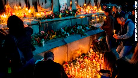 Bulgarians light candles during a vigil in memory of Viktoria Marinova in the city of Ruse on Monday