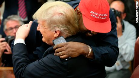 President Donald Trump embraces rapper Kanye West during a meeting at the Oval Office of the White House on October 11, 2018 in Washington, DC.