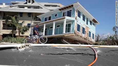 The hurricane carried a home across a road and slammed it against a condo complex in Mexico Beach.