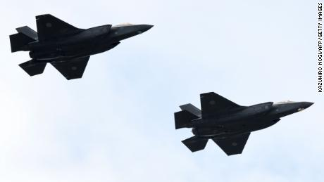 F-35 fighter aircraft from the Japan Air Self-Defense Force take part in a military review in 2018.