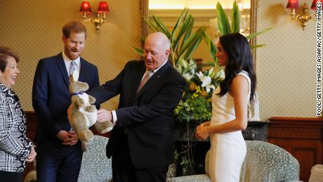 SYDNEY, AUSTRALIA - OCTOBER 16: Prince Harry and Meghan Markle look at a plush kangaroo with Australia's Governor-General Peter Cosgrove and his wife, Lynne Cosgrove.