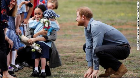 Meghan Duchess of Sussex gets a hug and a bouquet of flowers from 5-year-old Luke Vincent